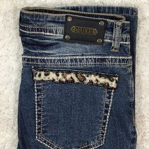 Tru Luxe animal print accent jeans